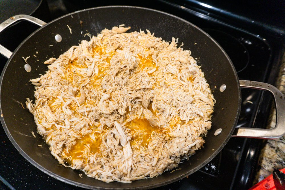 The chicken after its completely cooked and shredded